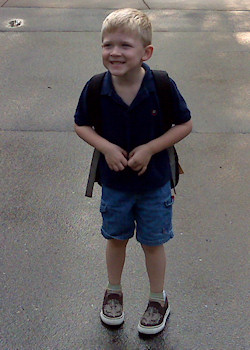 Luke, on his first day of kindergarten, waiting for the bus